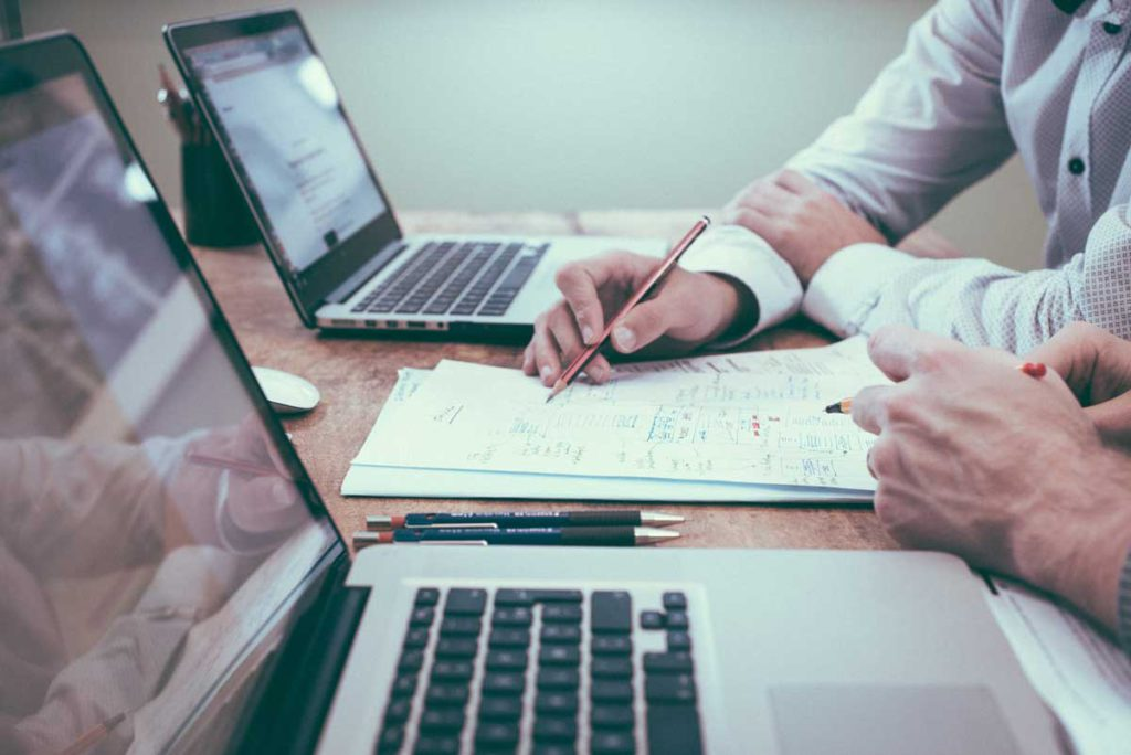 2 peron drafting web development on paper